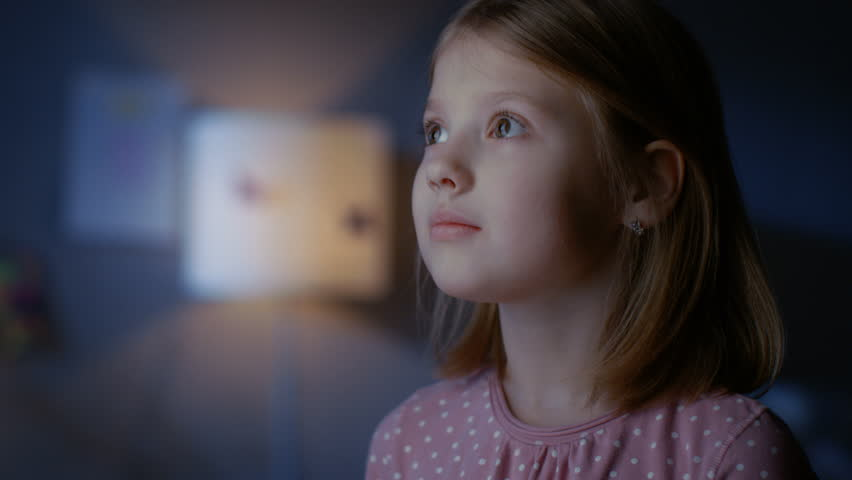 Wondrous Girl Happily Looks out of the Window. Shot on RED EPIC-W 8K Helium Cinema Camera.