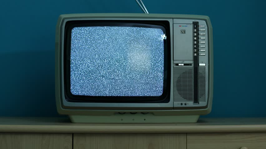 Static noise on a vintage TV set in a dim room