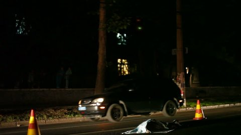The worst case accident, the dead body of a pedestrian on the night road
