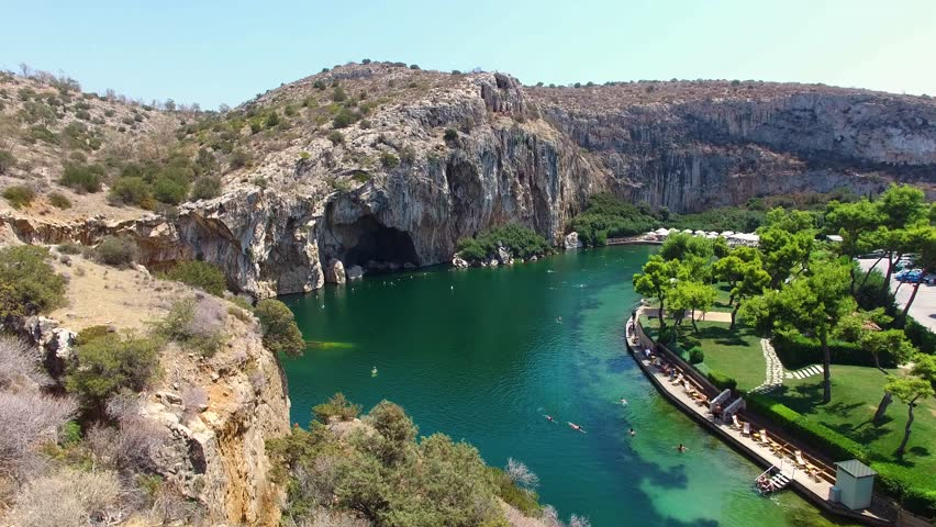 """Greece  Athens Aerial drone video of famous lake Vouliagmenis which means """"Sunken Lake"""" a rare geological formation, Athens Riviera, Attica, Greece   Shutterstock HD Video #25575401"""