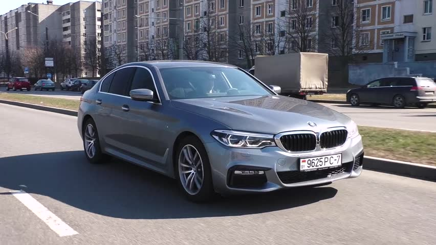 MINSK, BELARUS - APRIL 2, 2017: 2017 BMW 520d (G30) on the road. BMW 5 Series is dynamic and enjoyable to drive. In its seventh generation 5 Series is still created as an ultimate driving machine. #25583513