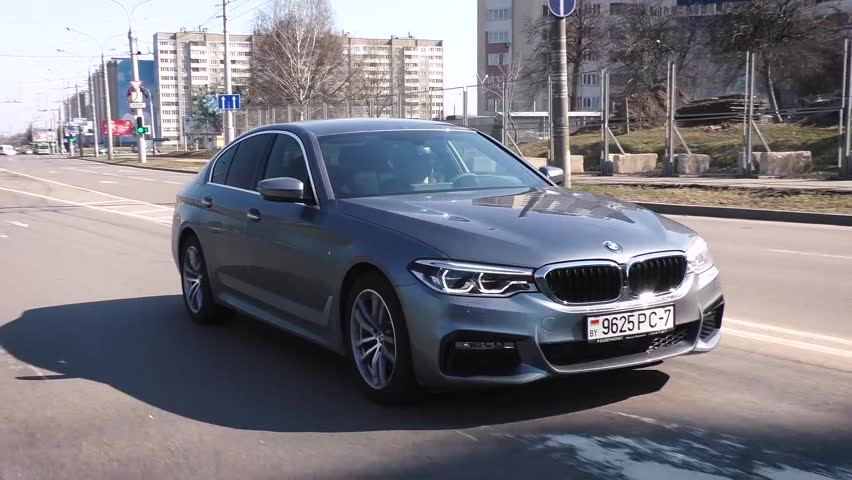 MINSK, BELARUS - APRIL 2, 2017: 2017 BMW 520d (G30) on the road. BMW 5 Series is dynamic and enjoyable to drive. In its seventh generation 5 Series is still created as an ultimate driving machine. #25583531