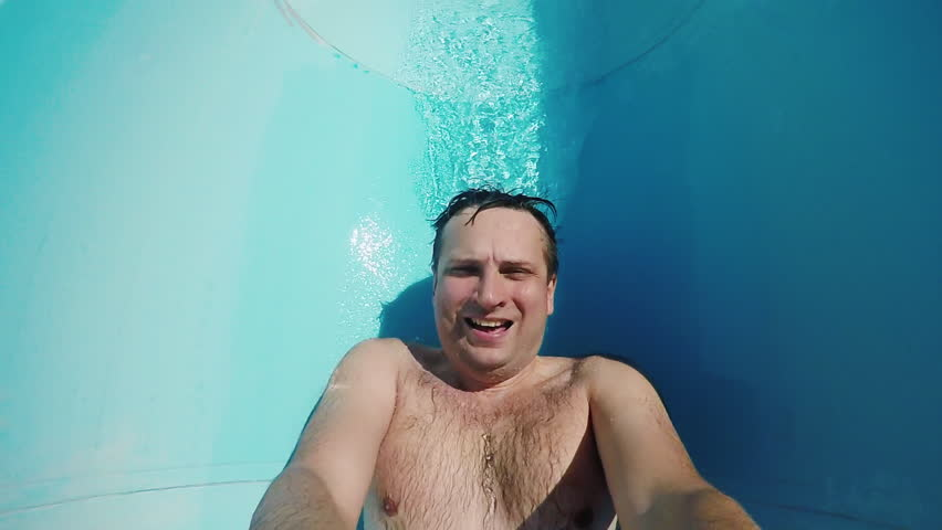 A funny man is riding on a water slide. Slow Motion POV Videos
