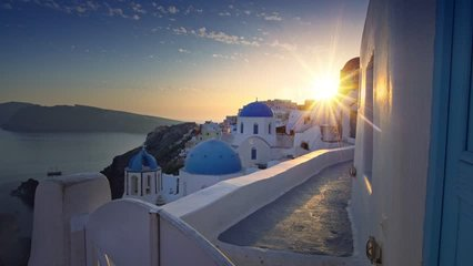 Santorini Greece famous village Oia sunset taken from steadicam handheld. Walk in Santorini streets. 4k quality video.