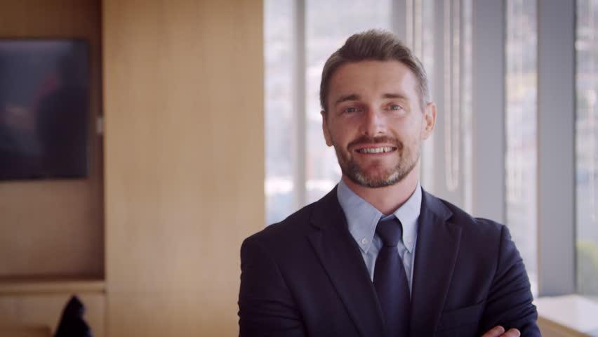 Portrait Of Businessman In Office Walking Towards Camera  #25599800