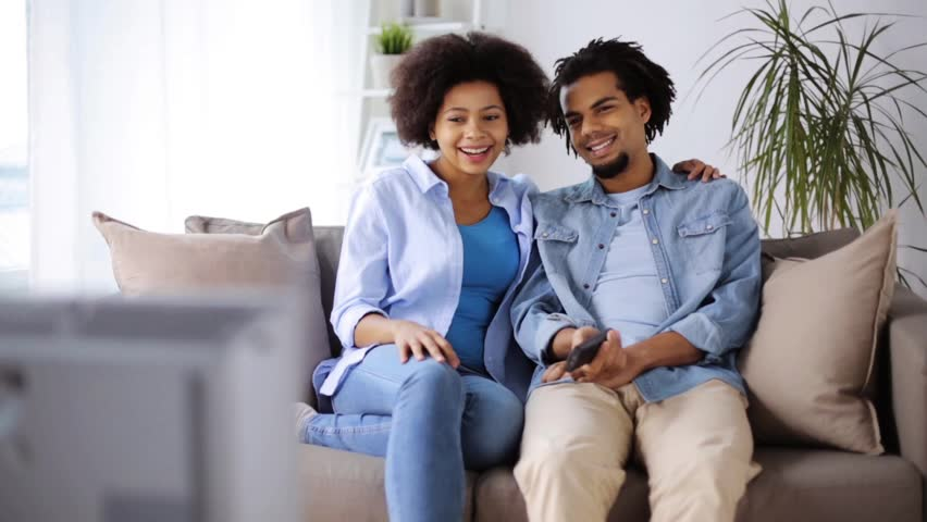 people, family and leisure concept - happy smiling couple watching tv at home #25606019