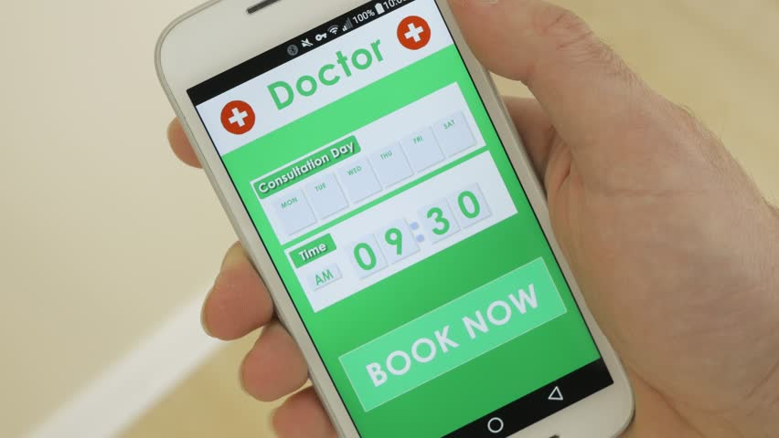 Using a smartphone to book a doctor appointment using an application.