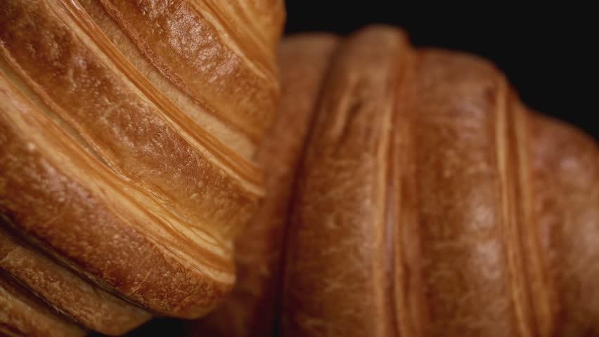 Fresh croissants on black background. Blur effect. Close up view #25618241
