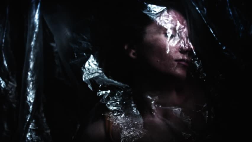 4K Horror Shot Of Dead Woman Waking up in Plastic Bag