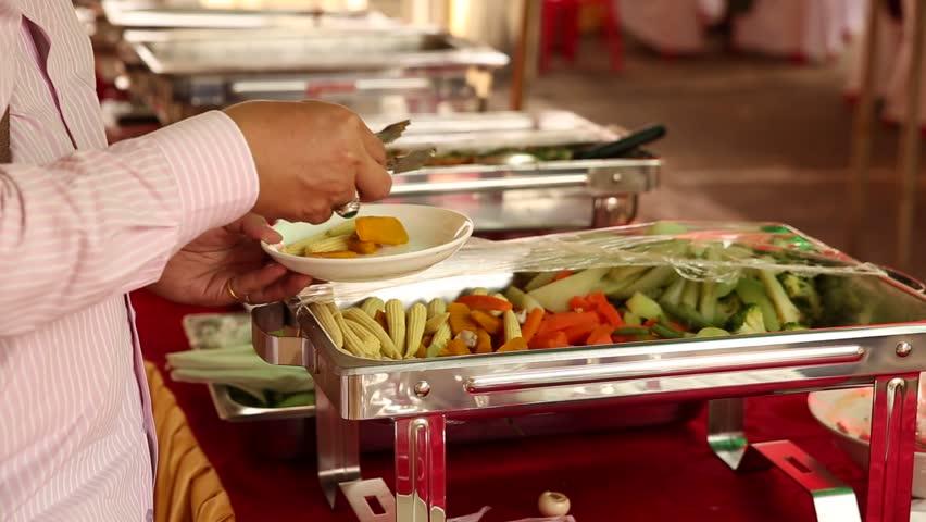 Buffet, vegetarian food (vegetable menu) at Laos wedding ceremony, asia food footage | Shutterstock HD Video #25631648