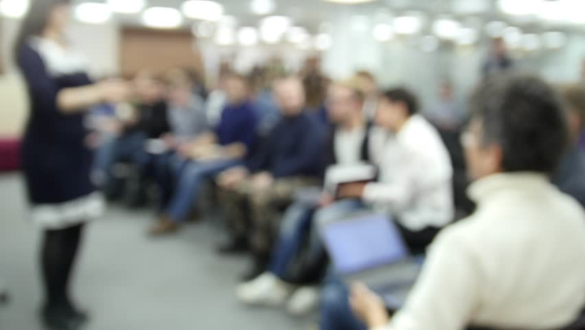 De-focused - a lot of people sitting at a seminar or lectures - time-lapse | Shutterstock HD Video #25641785