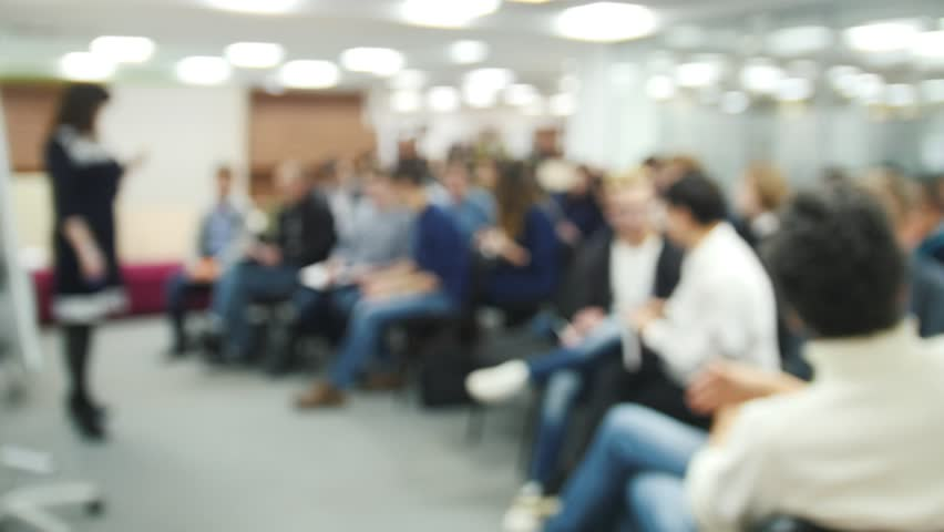De-focused - a lot of people sitting at a seminar or lectures - background | Shutterstock HD Video #25641791