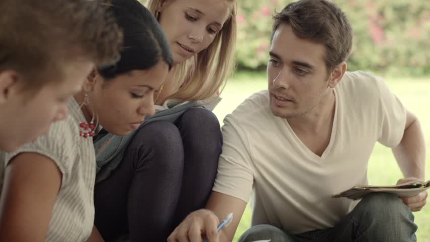 Friends and education, group of university students studying, reviewing homework and preparing test | Shutterstock HD Video #2564240