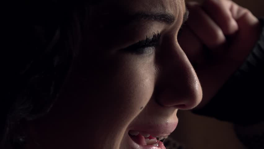 Depressed woman at the window crying desperately | Shutterstock HD Video #25649804