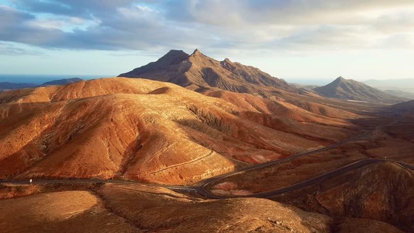 Flight over desert landscape, Fuerteventura island, Spain | Shutterstock HD Video #25656887