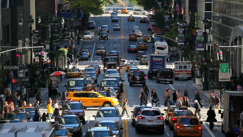 NEW YORK, NEW YORK - CIRCA MAY 2011: 42nd Street in Mid Town Manhattan with various cars and buses passing by | Shutterstock HD Video #2566232