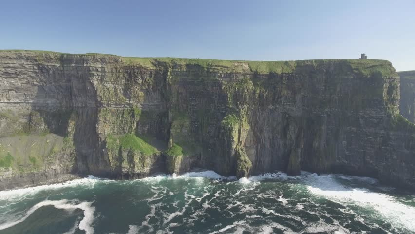 Aerial from Ireland countryside tourist attraction in County Clare. The Cliffs of Moher and Burren Ireland. Epic Irish Landscape Seascape along the wild atlantic way. Beautiful scenic nature Ireland | Shutterstock HD Video #25683875