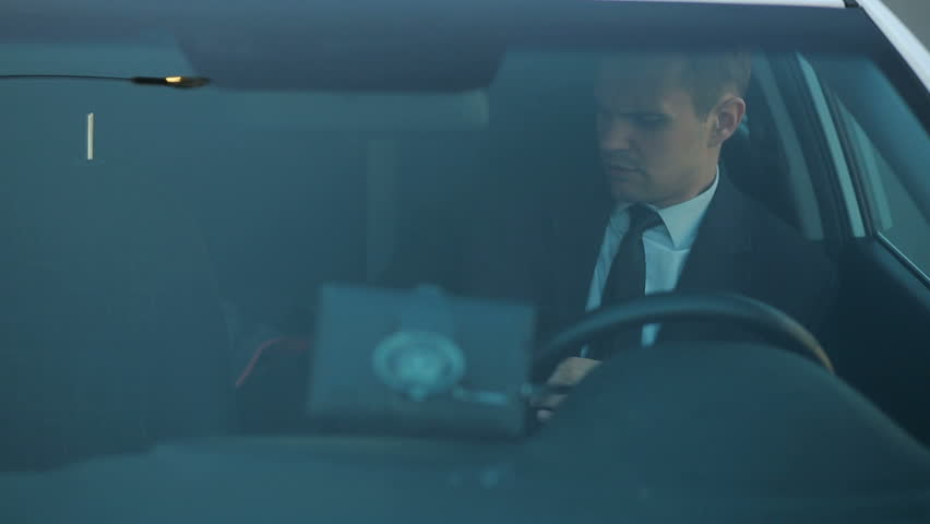 Businessman in the car, looking around, watching what is happening | Shutterstock HD Video #25697765