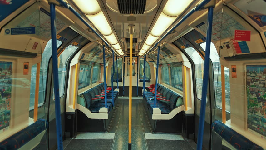 LONDON, April 2017 - Stress-free commuting - An ultra-wide angle symmetrical shot showing an empty carriage of the London Underground tube train