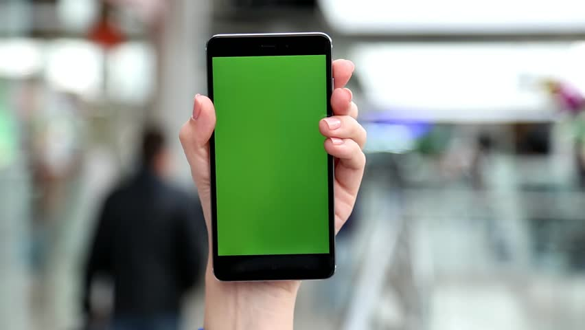 Closeup of white female hand holding moder smartphone with blanc chromakey green screen in big city mall. Real time full hd video footage. | Shutterstock HD Video #25709621