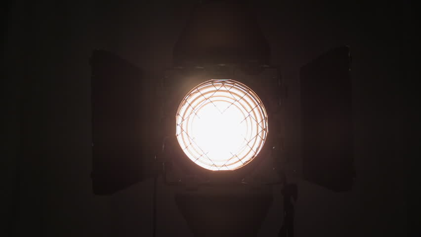 Footage of studio light being turned on and off. Floodlight flashes