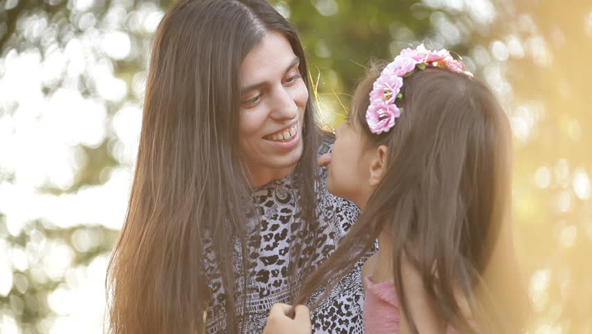Mother asking daughter and making faces to camera. Sunset back lit portrait. Shallow depth of field. | Shutterstock HD Video #25727771