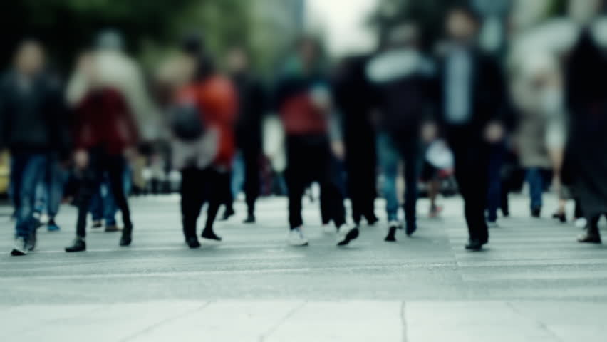 Crowd of pedestrians commute on a busy european city square 100p.100 fps dolly shot of a crowd of pedestrians with their backs towards camera walking on a busy european city square. #25744565
