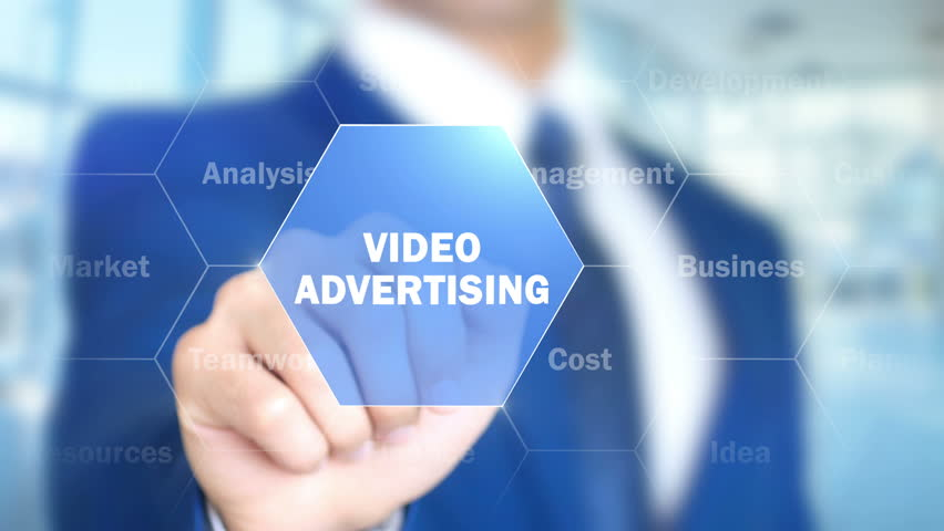 Video Advertising, Businessman working on holographic interface, Motion Graphics | Shutterstock HD Video #25748795