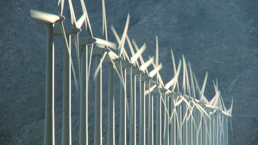 Wind turbines producing clean alternative energy in barren landscape | Shutterstock HD Video #25750808