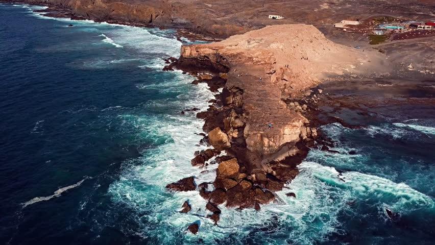 Flying over cliff in La Pared, Fuerteventura, Canary Islands. | Shutterstock HD Video #25770419