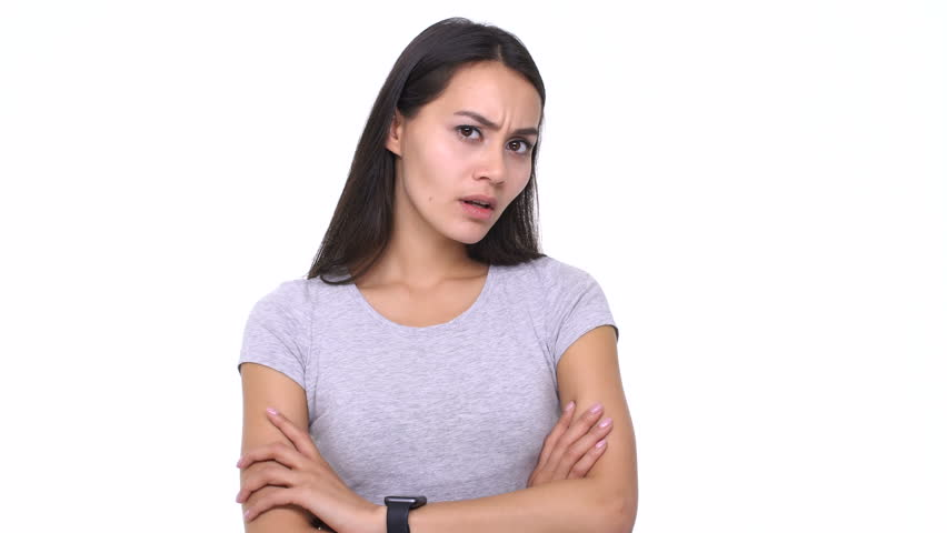 Unsatisfied disappointed young asian woman showing thumbs down gesture isolated over white  | Shutterstock HD Video #25772588