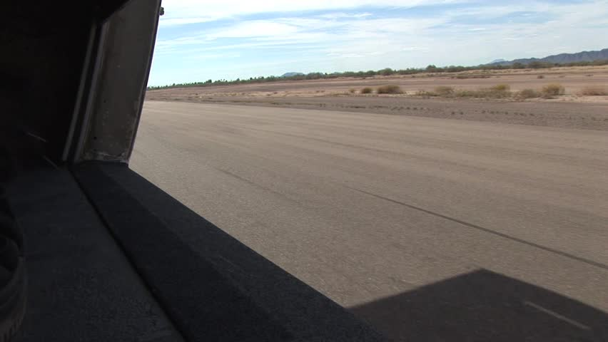 View of Runway From A Prop Plane Moving Down The Runway