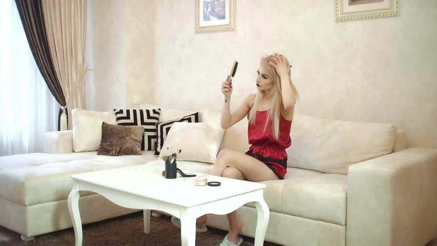 Beautiful girl combing her hair and preen | Shutterstock HD Video #25791026