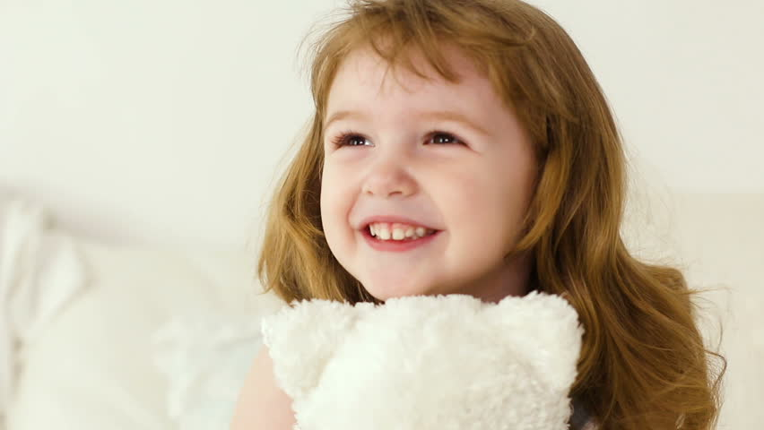 Redhead girl with long hair two years of hugs white Teddy bear   Shutterstock HD Video #25794386