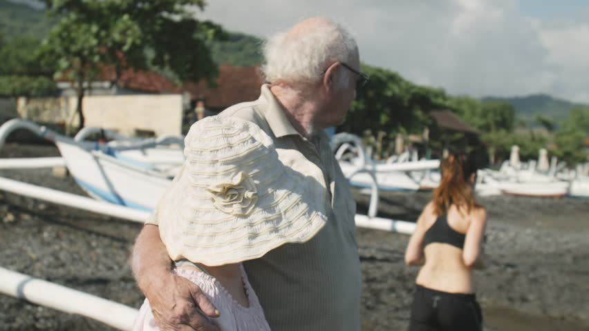Elderly couple looking at the running girl