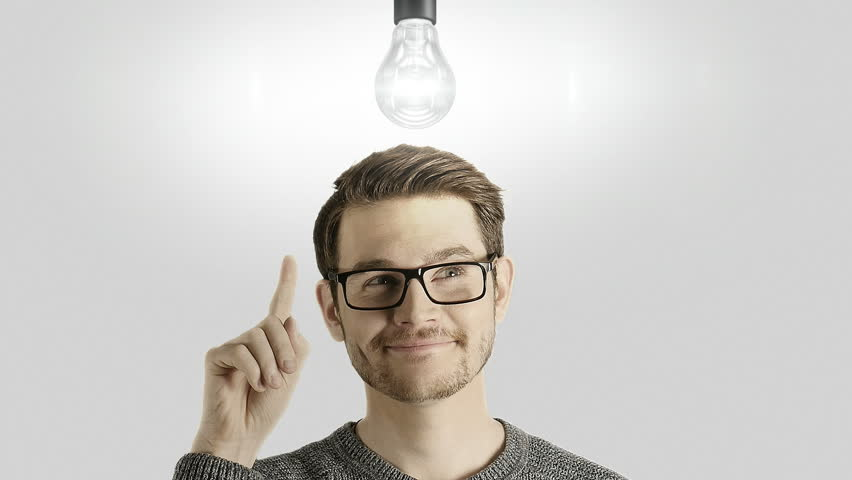 Clever creative man think gets an idea, which lights up a symbolic lamp over his head on white background