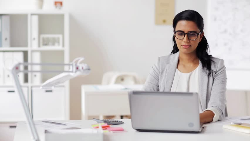 business, people, deadline and technology concept - stressed businesswoman with laptop computer at office Royalty-Free Stock Footage #25825154
