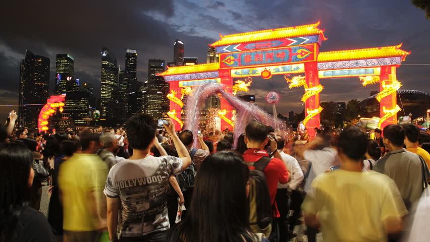 SINGAPORE - CIRCA MAY 2011: people near River Hongbao decorations for Chinese New Year celebrations at Marina Bay