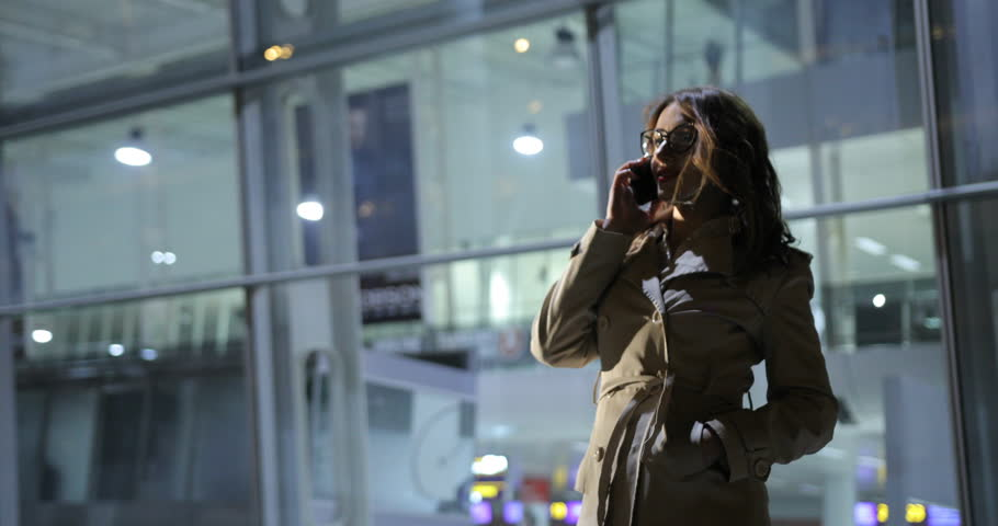 Beautiful woman is making a phone call, outdoors in the city at night. | Shutterstock HD Video #25833239