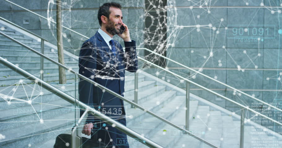 A businessman the stairs are coming down in a suit uses holography and augmented reality to see in 3D graphics financial economics. Concept: immersive technology, business, economy, futuristic | Shutterstock HD Video #25845233