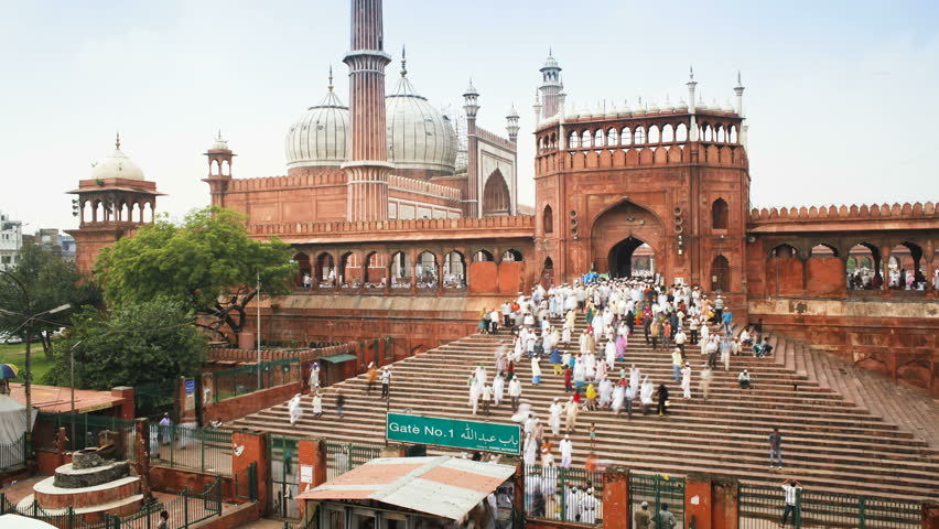 OLD DELHI, INDIA - CIRCA MAY 2011: People leaving the Jama Masjid (Friday Mosque) after the Friday Prayers