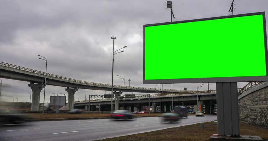 Billboard green screen near the transport interchange. time laps | Shutterstock HD Video #25858544