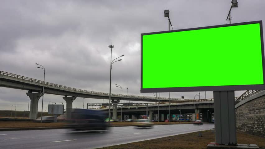 Billboard green screen near the transport interchange. time laps | Shutterstock HD Video #25858556