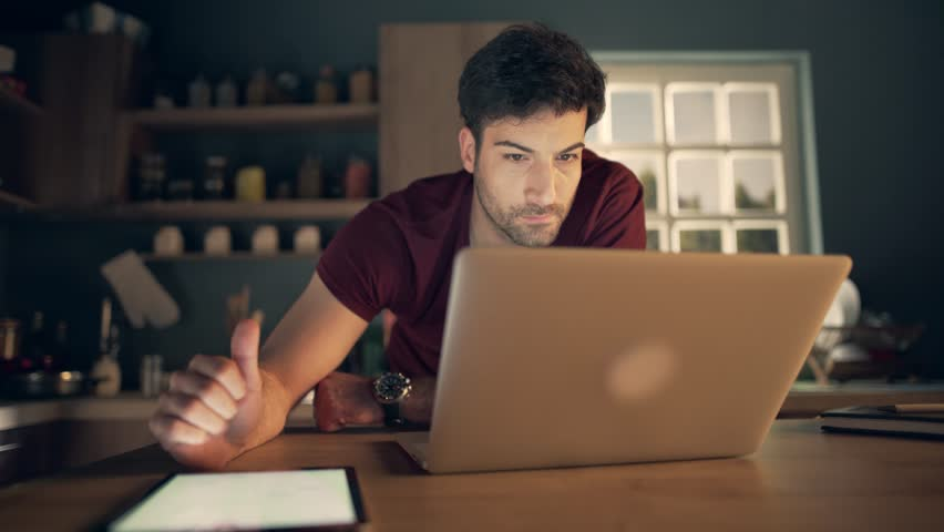 Young businessman using laptop and tablet | Shutterstock HD Video #25858640