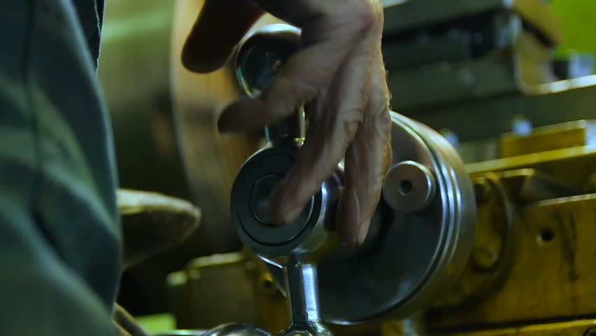 Closeup slow motion professional worker hands gently turn lathe machine metal level in plant workshop | Shutterstock HD Video #25865396