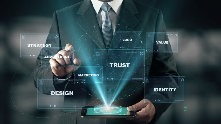 Businessman with Brand hologram concept choose Advertising from words | Shutterstock HD Video #25884593