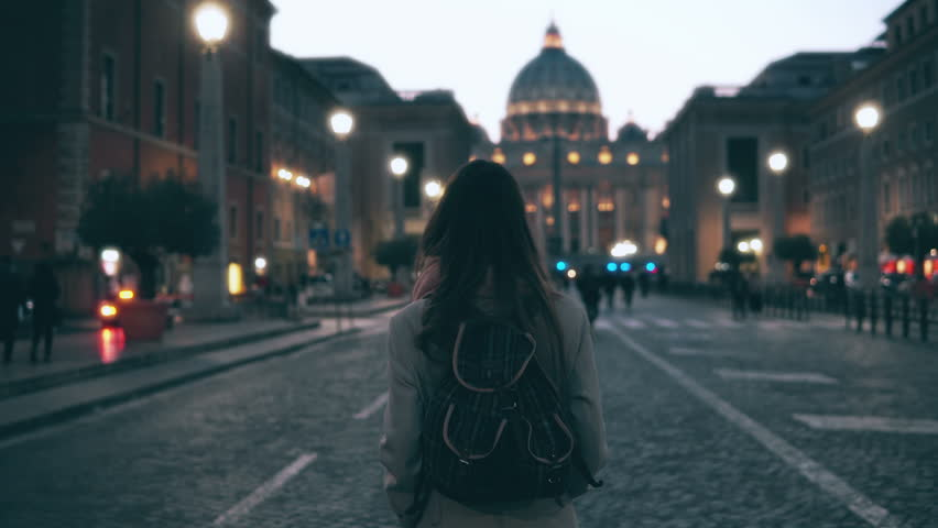 Young tourist woman walking in Piazza di spagna near the Saint Peter Cathedral. Girl looking around, exploring sights. | Shutterstock HD Video #25886900