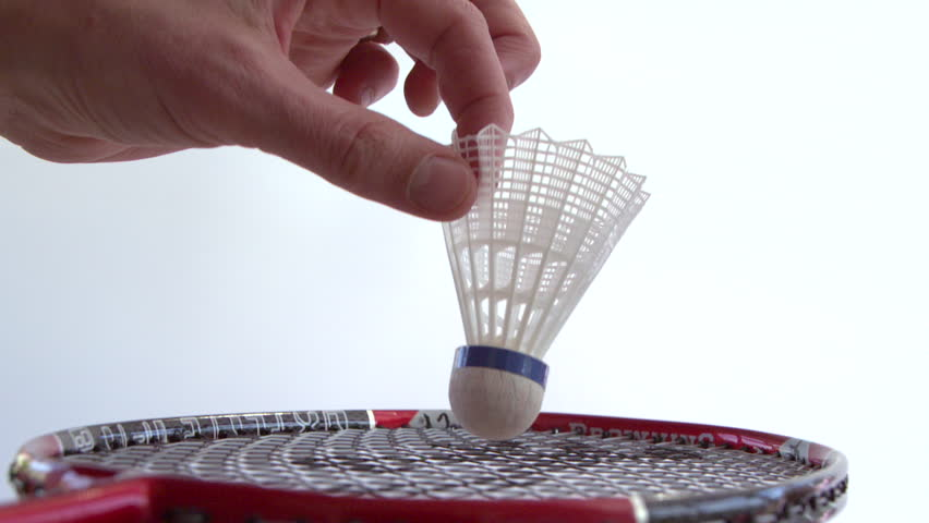 Hitting a shuttlecock with a badminton racket