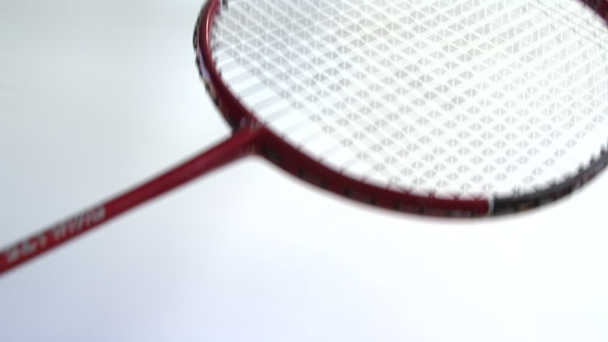 Slow motion badminton racket hitting a shuttlecock