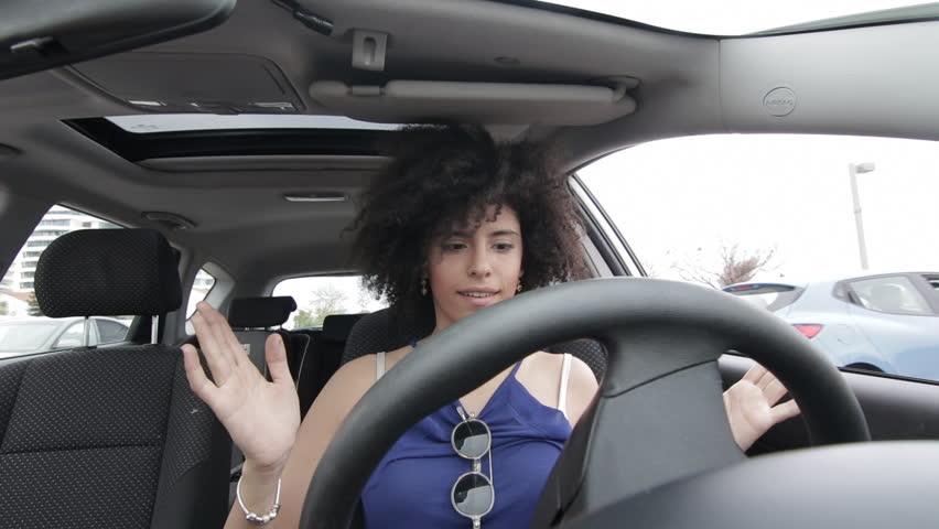 Woman driving an autonomous car | Shutterstock HD Video #25911029